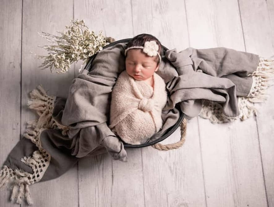 baby wrapped in blanket - testimonial for Alicia P.